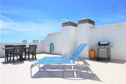 PE3_Roof_terrace_with_stunning_sea_views_and_BBQ_receives_plenty_of_sun.jpg