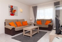 PP8_Lounge_with_comfortable_sofas_and_access_to_the_terrace-1.jpg