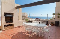 MB7_Outside_dining_area_with_sea_views_and_barbecue.jpg