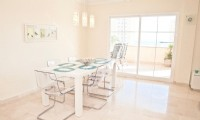 PA3_Dining_area_in_the_apartment_with_access_to_the_terrace_.jpg