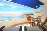PE3__Another_picture_of_the_balcony_with_dining_area_and_sunloungers.jpg